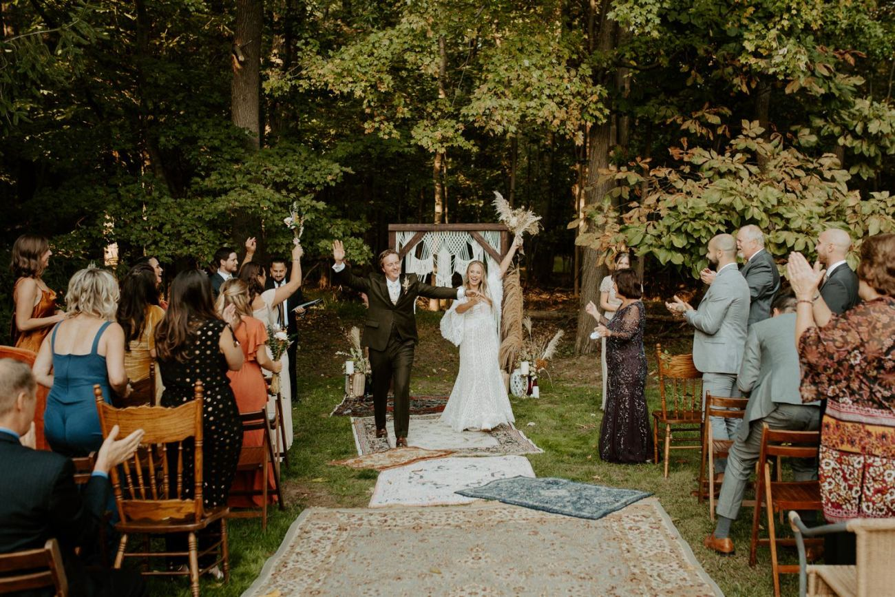 Bride and Groom walking down the aisle at their Backyard Wedding in New Jersey