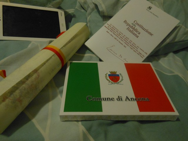 The marriage certificate. Italian Constitution and the Italian flag. You know I am a foreigner