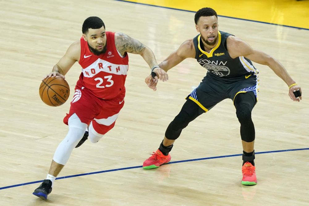 Fred VanVleet drives past Golden State's Stephen Curry. VanVleet personifies the resilience shown by many Raptors players. (Thearon W. Henderson/Getty Image)