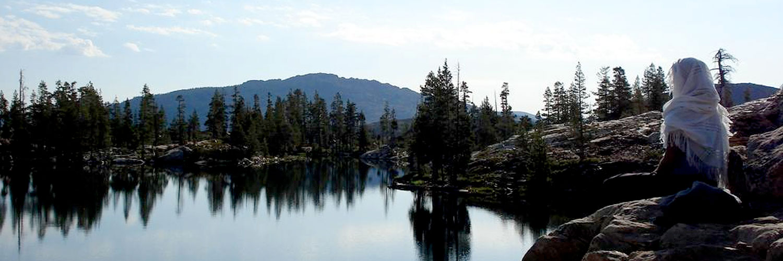 gap year student meditating by lake