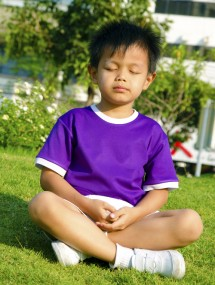 Young boy meditating small