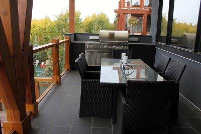deck-overlooking-backyard-outdoor-kitchen