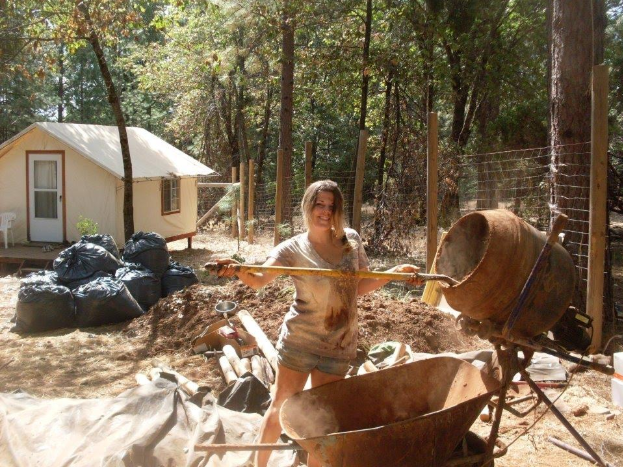 Kayla working on the hand-built cob temple the college students built themselves