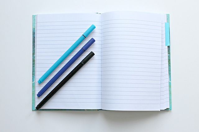 Notebook with three pens