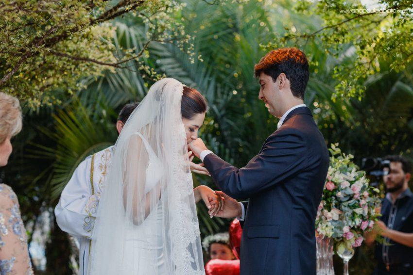 couple exchange rings in inspiring summer wedding