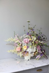 pastel summer flower arrangement with white hydrangea, roses, Queen Anne's lace, foxgloves, heuchera and everlasting pea // stylist Anastasia Benko