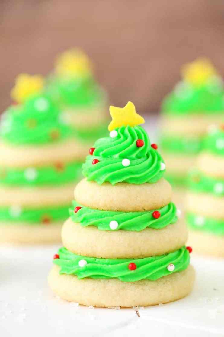 Christmas Tree Cookie Stacks - Best Christmas Desserts - Recipes and Christmas Treats to Try this Year! Try these amazing and cute easy Christmas dessert recipes to have a great party for your kids, friends, and family! Cupcakes, cakes, sweet bites, pies, brownies, home-made Christmas popcorn, Christmas cookies and other delights. #christmas #dessertfoodrecipes #xmas #recipes #food #christmasfood