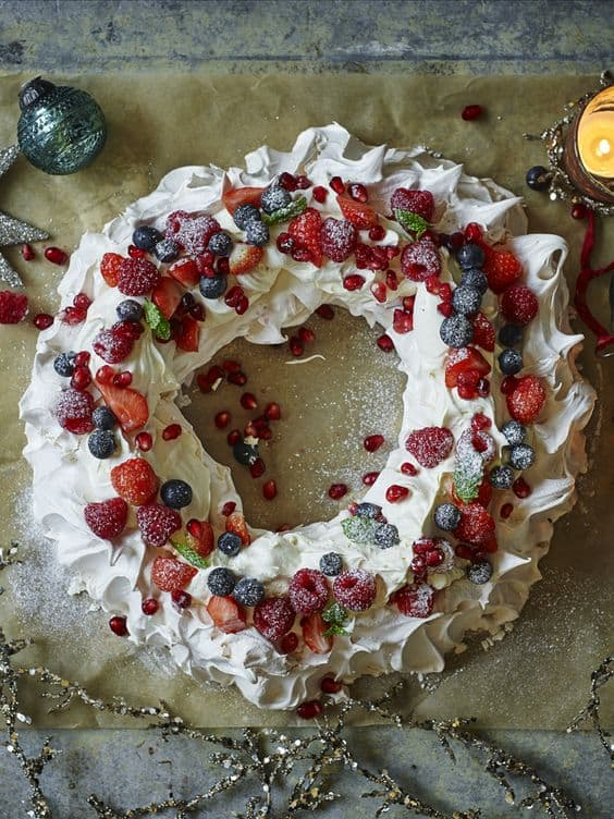 Christmas Pavlova - Best Christmas Desserts - Recipes and Christmas Treats to Try this Year! Try these amazing and cute easy Christmas dessert recipes to have a great party for your kids, friends, and family! Cupcakes, cakes, sweet bites, pies, brownies, home-made Christmas popcorn, Christmas cookies and other delights. #christmas #dessertfoodrecipes #xmas #recipes #food #christmasfood