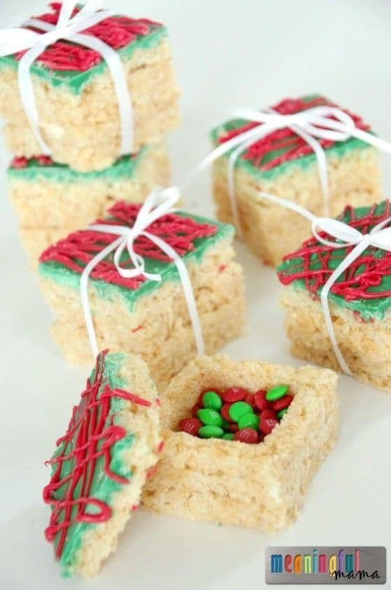 Rice Krispies Treats Presents with a Surprise - Best Christmas Desserts - Recipes and Christmas Treats to Try this Year! Try these amazing and cute easy Christmas dessert recipes to have a great party for your kids, friends, and family! Cupcakes, cakes, sweet bites, pies, brownies, home-made Christmas popcorn, Christmas cookies and other delights. #christmas #dessertfoodrecipes #xmas #recipes #food #christmasfood