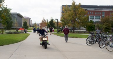 A Central Michigan University student takes one last ride by Moore Hall on his electric scooter before the weather changes. Central Michigan University in Mt. Pleasant, Michigan October 18, 2016.