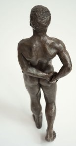 cranial dorsal view of bronze sculpture of male nude standing figure