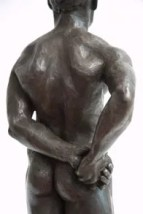 Bronze sculpture of a male nude standing