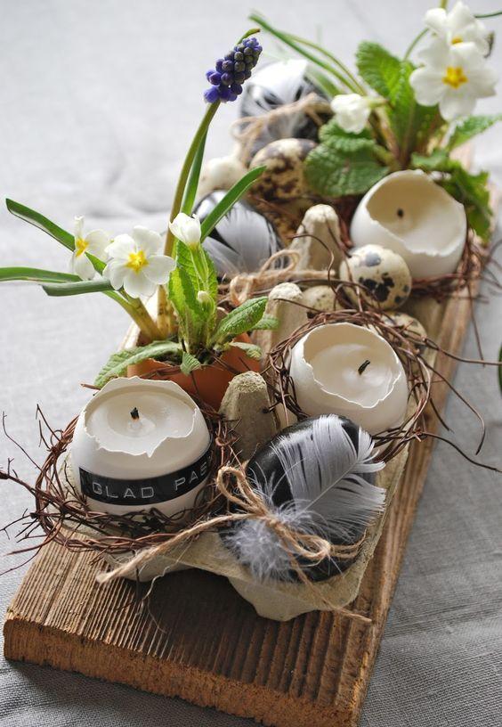 Centro de mesa hecho con elementos naturales como: huevos, plantas y corteza de árbol, decoración de mesa de Pascua