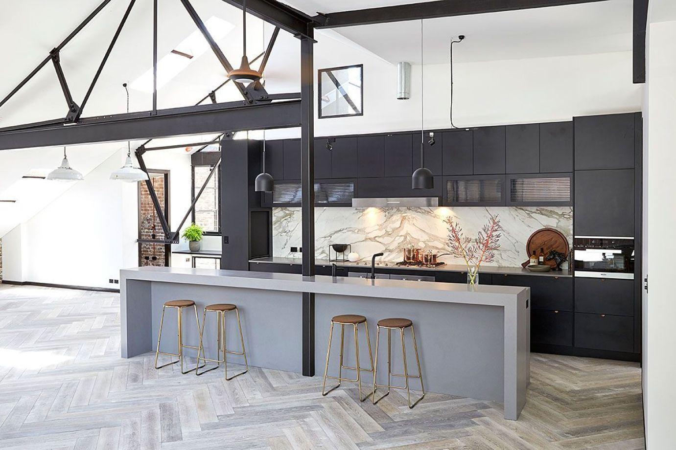 Cocina de estilo Industrial abierta a salón