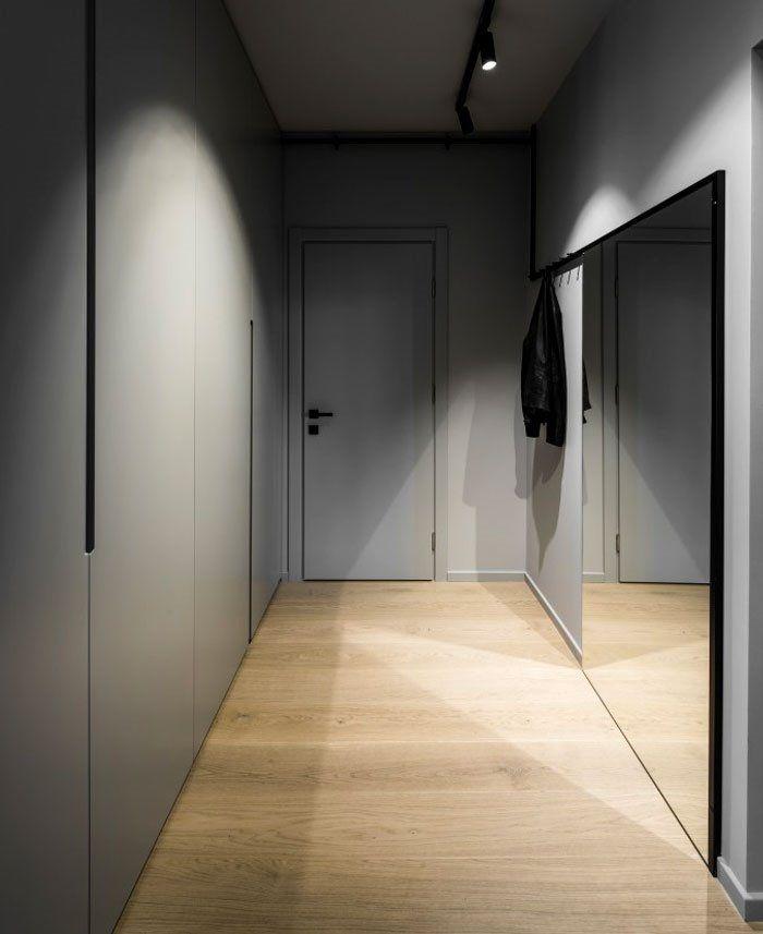 Entrada de estilo minimalista y colores neutros de apartamento de 46 m2