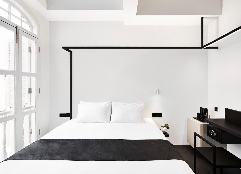 Interiorismo comercial de hotel Mono habitación de estilo minimalista y funcional @Utrillanais
