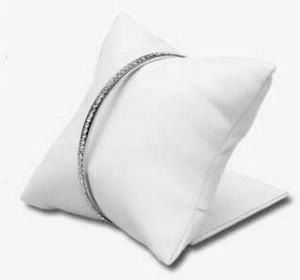 a c display co white watch bracelet pillow on a stand