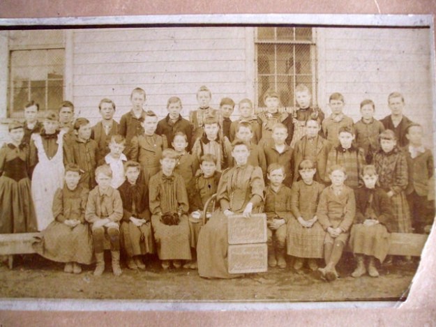 Killbuck School, Vera Anderson to left of teacher. 1893