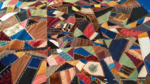 crazy quilt with pieces of wedding dress.