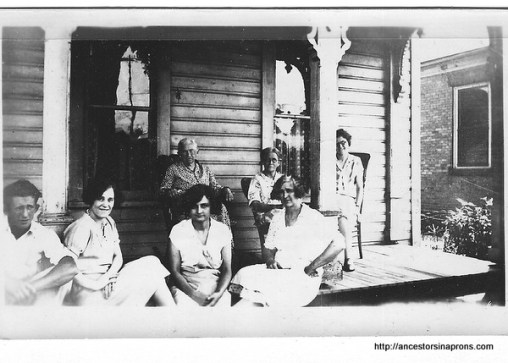 Aunt Lib Stout can be seen sitting to the left of the porch post in this picture taken on the porch of Hattie Morgan Stout (to Lib's left). One of Lib's daughters is on the far right in back.