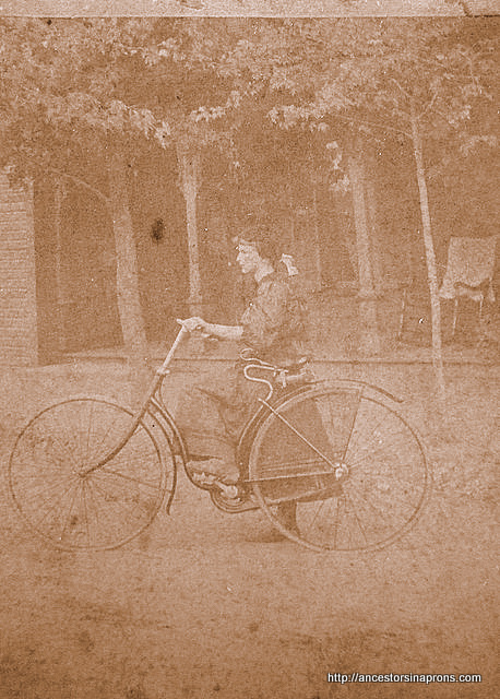 Vera Stout Anderson, young woman athlete on her bike.