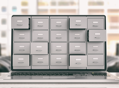 file cabinet with open drawers representing IT solutions and options