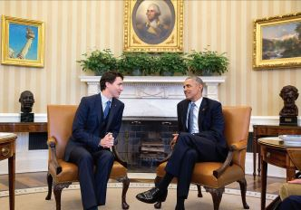 LEADERS MEET — Justin Trudeau and Barack Obama talk.