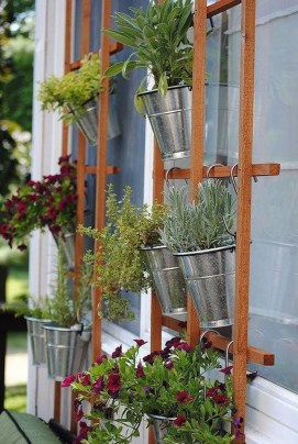 Basic Exterior Wall Into an Elegant Vertical Garden to Perfect Your Garden 15