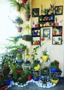Basic Exterior Wall Into an Elegant Vertical Garden to Perfect Your Garden 19