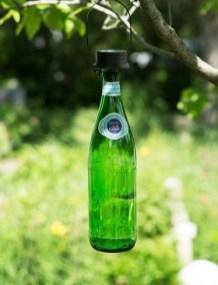 Charming Backyard Ideas Using an Empty Glass Bottle13
