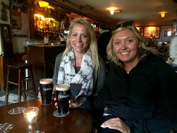 A stop at Sean's Bar is one of the many things to see between Dublin and Galway. There are two women drinking a beer in the bar.
