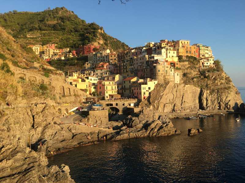 A photo of the cliffs and buildings in Manarola, one of the towns in Cinque Terre.