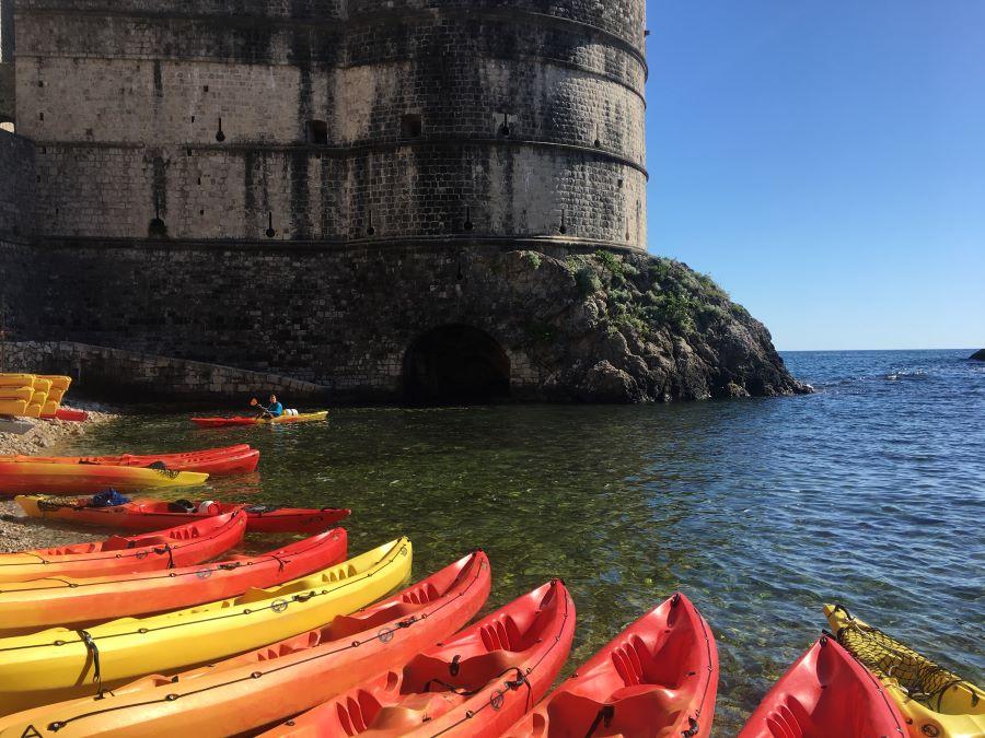 Orange kayaks on the beach in Dubrovnik.