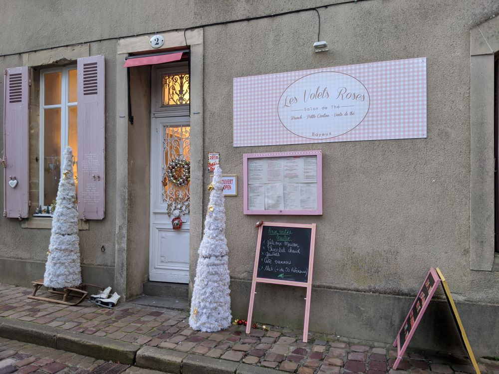 The exterior of this coffee house is decorated in pink.
