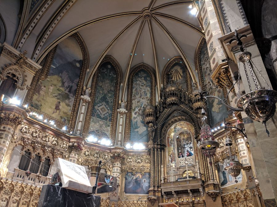 The ceiling of a catholic church in Montserrat Spain. Here you see the alter and organs.