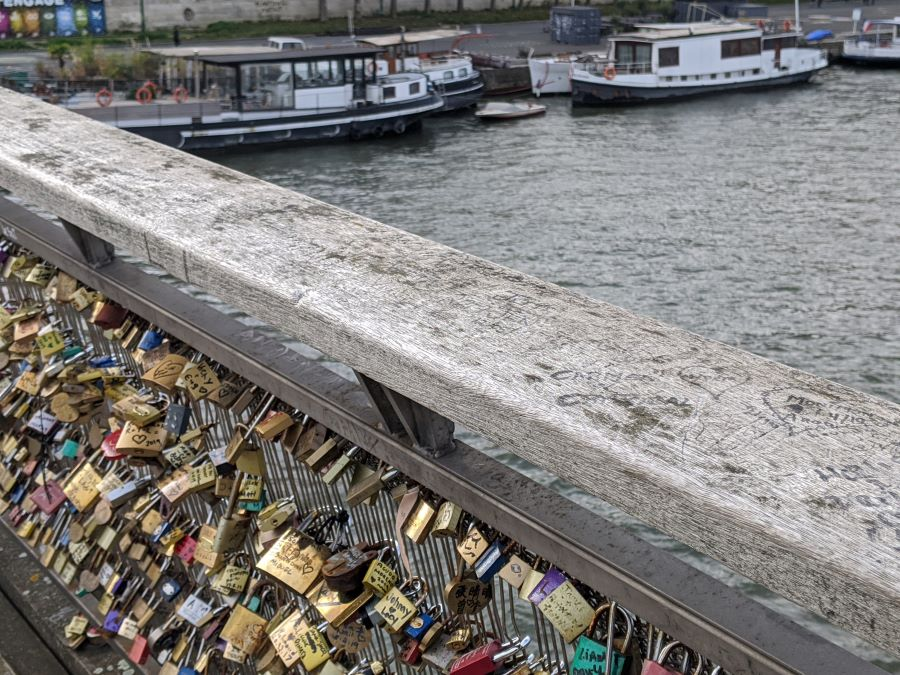 Hundreds of locks attached to the side of bridge in Paris.