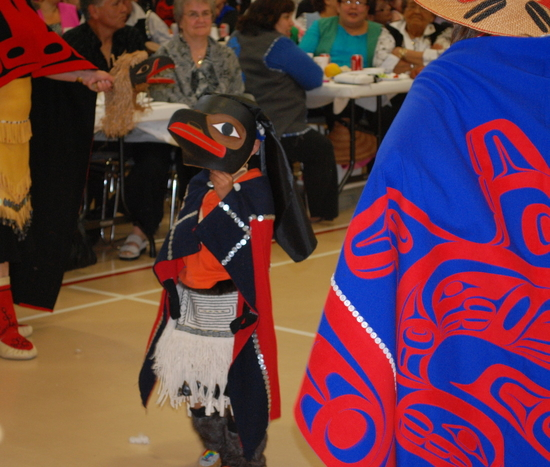 Small raven dancer at a memorial feast