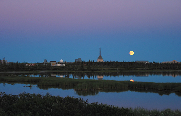 At twilight, the moon hangs over the old Churchill rocket range.