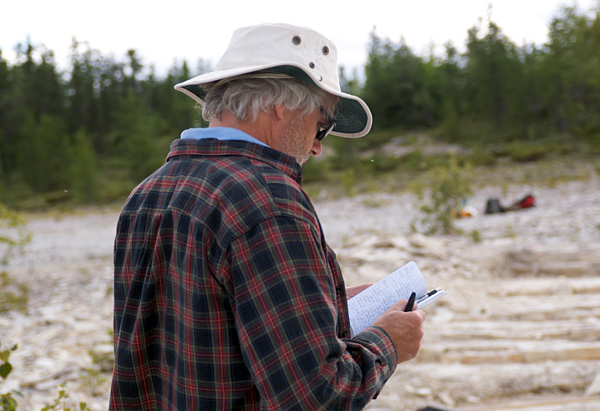 A scruffy paleontologist fills in his field notebook.  The two shirts are not some sort of ill-planned fashion statement; I was cold that day! (photo © Michael Cuggy)