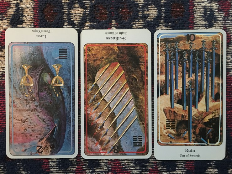 Two of Cups (reversed), Eight of Wands (reversed), and Ten of Swords