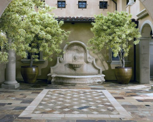 Antique Stone Fountain inside a courtyard wall