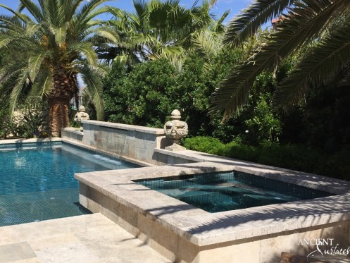 Antique limestone pool coping with stone flooring