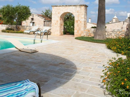Antique limestone pool coping with outdoor limestone flooring