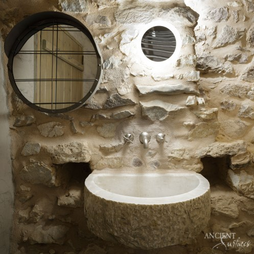 antique-limestone-stone-hand-carved-sink-in-a-powder-room