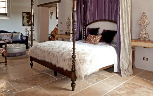 Castello di Santa Eurasia Bedroom with limestone flooring