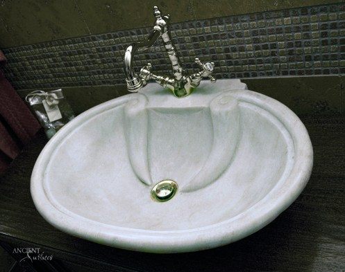 Shell Shaped Marble Sink in Powder Room by Ancient Surfaces