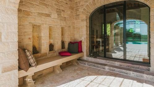 outdoor-seating-area-cosy-farmhouse-limestone-benches-limestone-wall-cladding-limestone-stone-antique-flooring-floors