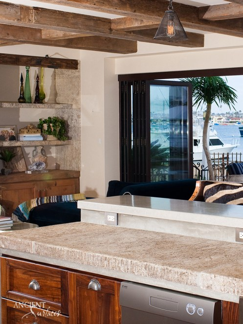limestone-kitchen-coutertop-wood-beams-limestone-wall-cladding