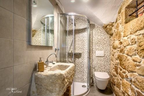 beautiful-bathroom-design-ideas-limestone-sink-with-stone-wall-cladding