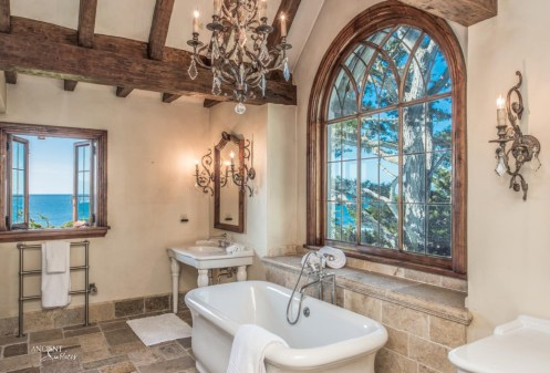 beautiful-bathroom-design-limestone-flooring-with-a-majestic-marble-tub-and-wood-beams